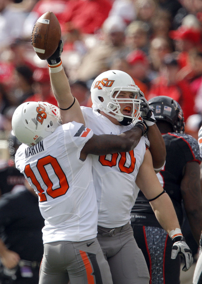 Oklahoma State's Cooper Bassett (80) and Markelle Martin (10) celebrate an interception during a college football game between Texas Tech University (TTU) and Oklahoma State University (OSU) at Jones AT&T Stadium in Lubbock, Texas, Saturday, Nov. 12, 2011.  Photo by Sarah Phipps, The Oklahoman  ORG XMIT: KOD