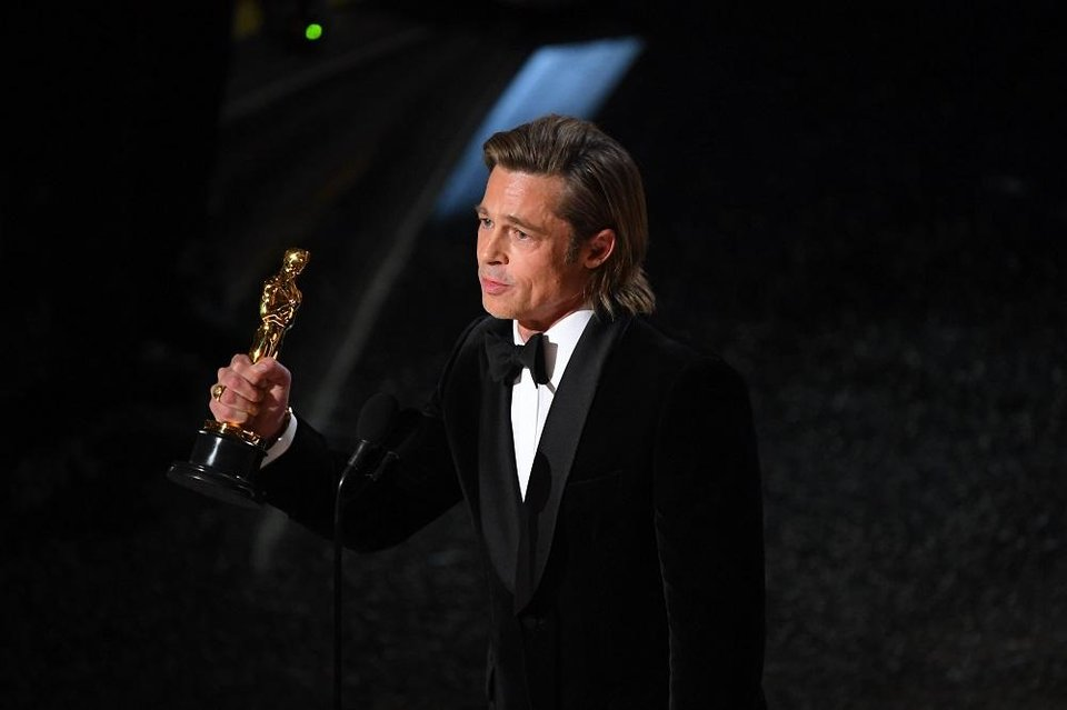 Photo - Brad Pitt accepts the award for best performance by an actor in a supporting role for his role in