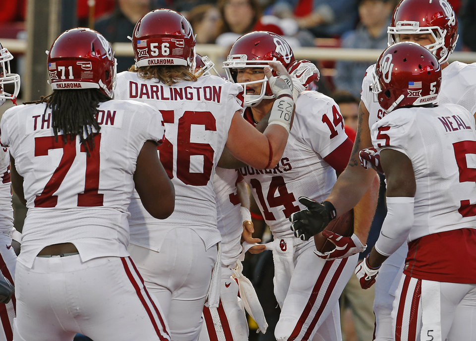 Photo - Oklahoma's Cody Thomas (14) celebrates after running for a touchdown during the college football game between the University of Oklahoma Sooners (OU) and the Texas Tech Red Raiders at Jones AT&T Stadium in Lubbock, Texas, Saturday, November 15, 2014.  Photo by Bryan Terry, The Oklahoman