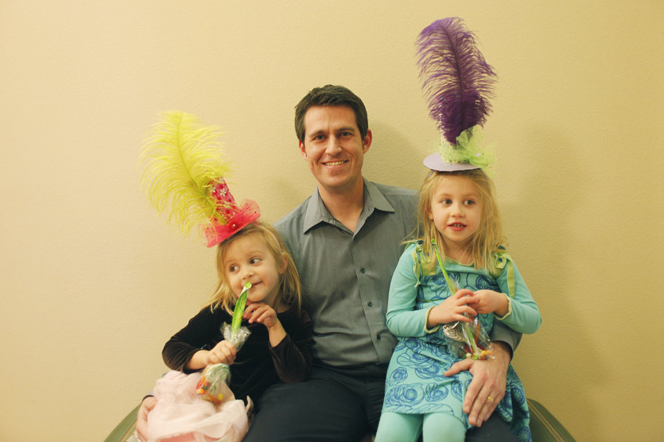 Trevor Snyder and his 5 year old twin daughters Hannah, left, and Olivia, right,  at the Daddy-Daughter Mad Hatter Tea Party at the Edmond Multi-purpose Community Center Sunday, Feb. 12, 2012. Photo by Doug Hoke, The Oklahoman ORG XMIT: OKC1202091803570754
