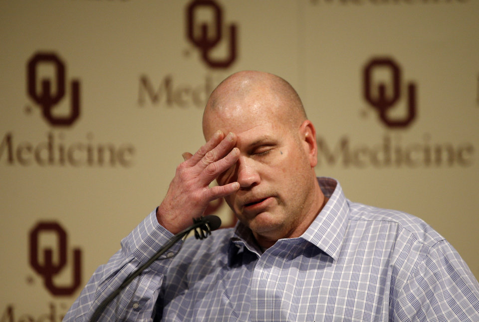Photo - Joe Wethington wipes his eye as he talks about the skydiving accident that badly injured his daughter Makenzie, 16, of Joshua, Texas, at the OU Medical Center in Oklahoma City, Tuesday, Jan., 28, 2013. Makenzie and her father traveled from Joshua, Texas, to Chickasha, Okla., on Saturday to skydive. Photo by Bryan Terry, The Oklahoman