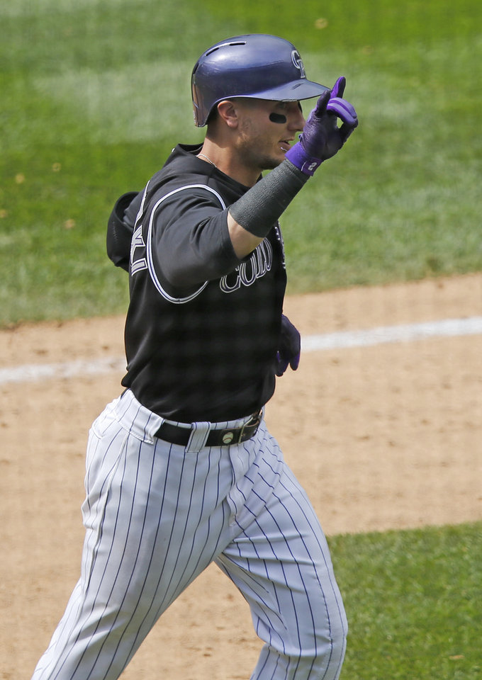 Photo - Colorado Rockies' Troy Tulowitzki celebrates his second home run of the day against the San Diego Padres during the eighth inning of a baseball game on Wednesday, July 9, 2014, in Denver. (AP Photo/Jack Dempsey)