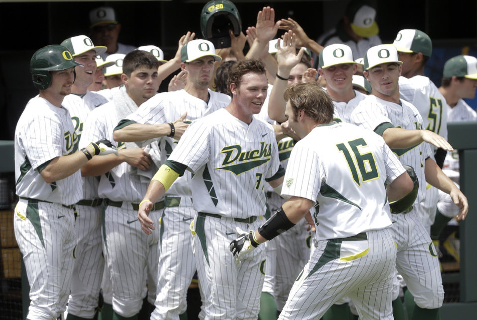 Photo - Oregon catcher Shaun Chase (16) is congratulated after hitting a three-run home run against Clemson during the fourth inning of an NCAA college baseball regional tournament game Friday, May 30, 2014, in Nashville, Tenn. (AP Photo/Mark Humphrey)