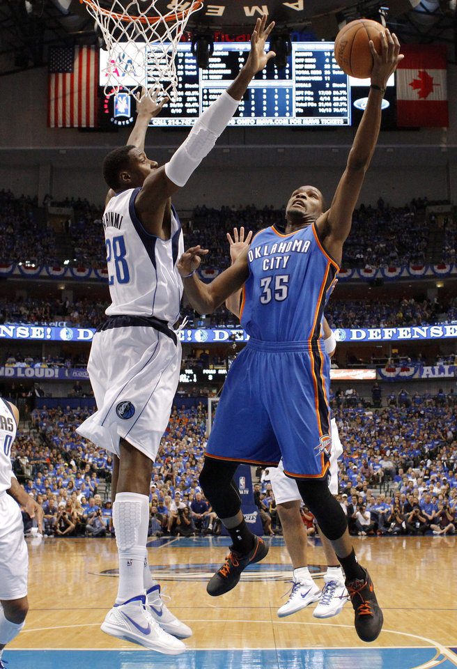 Photo - Oklahoma City's Kevin Durant (35) goes past Dallas' Ian Mahinmi (28) during Game 4 of the first round in the NBA playoffs between the Oklahoma City Thunder and the Dallas Mavericks at American Airlines Center in Dallas, Saturday, May 5, 2012. Oklahoma City won 103-97.  Photo by Bryan Terry, The Oklahoman
