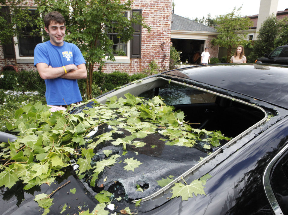 Nichols Hills resident Phillip Farha looks at his car which had its windows knocked out by up tennis ball-size hail after a severe thunderstorm moved through Nichols Hills and NW Oklahoma City , Sunday, May 16, 2010. By Paul Hellstern, The Oklahoman