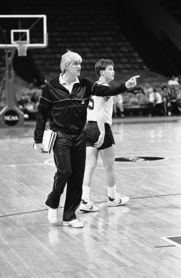 Photo - Georgia Tech coach Bobby Cremins walks past player Mark Price as they worked out at the Omni preparing for Thursday's NCAA southeast regional game against LSU, Wednesday, March 20, 1986, Atlanta, Ga. (AP Photo/John Storey)