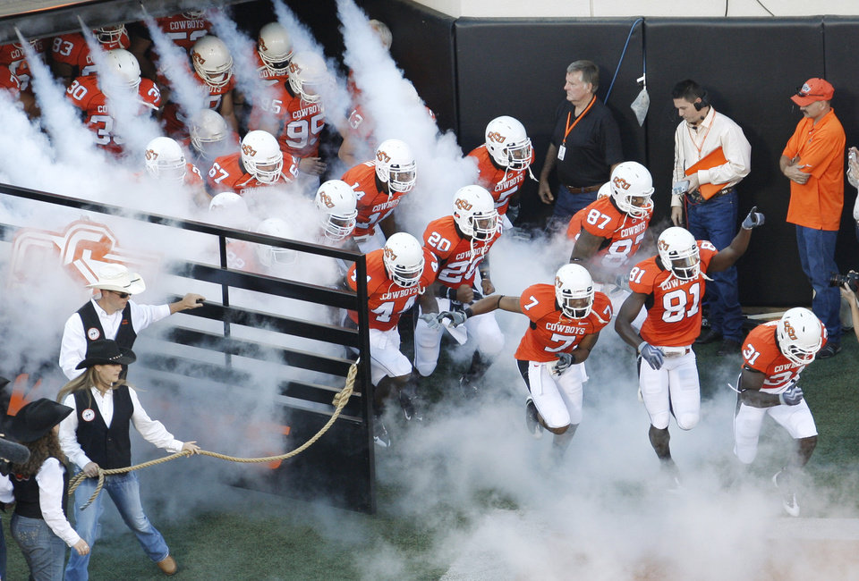 The Cowboys enter the field during the college football game between the Oklahoma State University Cowboys (OSU) and the Grambling State University Tigers (GSU) at Boone Pickens Stadium in Stillwater, Okla., Saturday, September 26, 2009. Photo by Doug Hoke, The Oklahoman ORG XMIT: KOD