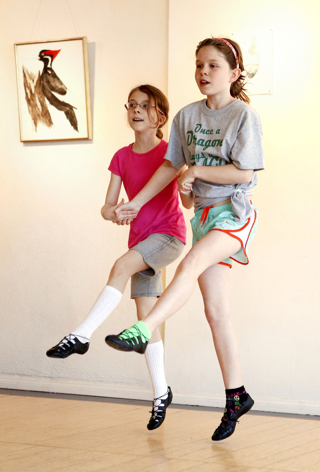 Photo - Camryn Odell and Lauren Sager dance as children take Jean Hill's Irish Dancing class at Sonder Music, Dance & Arts on Friday, April 12, 2013 in Norman, Okla.  Photo by Steve Sisney, The Oklahoman