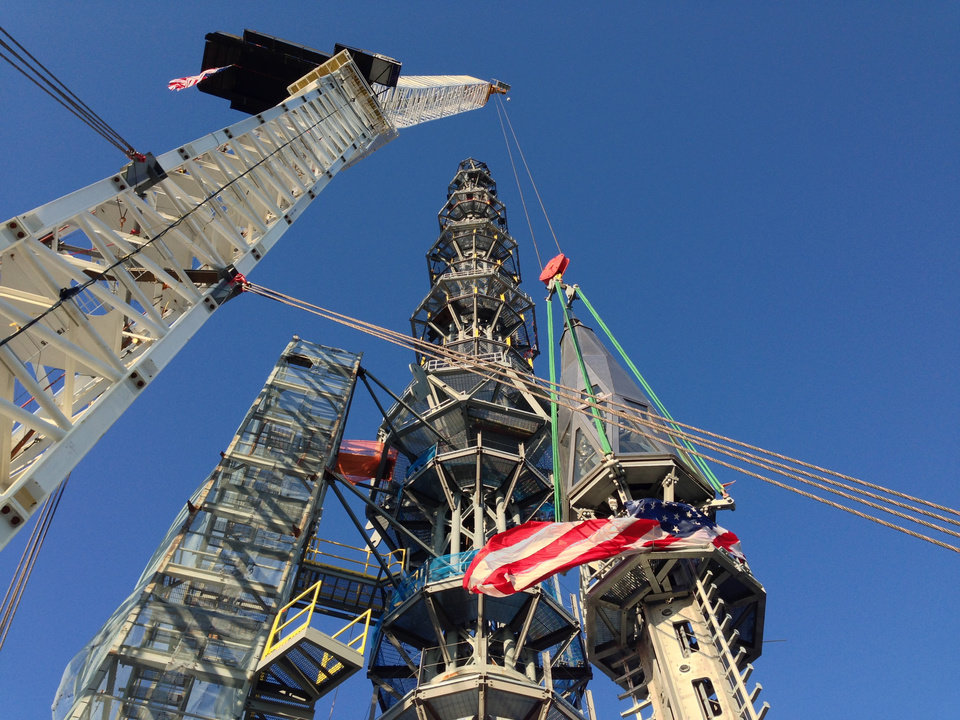Photo - FILE - In this May 10, 2013 file photo, the silver spire topping 1 World Trade Center is fully installed on the building's roof, bringing the structure to its full, symbolic height of 1,776 feet in New York. The new World Trade Center tower in New York knocked Chicago's Willis Tower off its pedestal as the nation's tallest building when an international panel of architects announced Tuesday, Nov. 12, 2013 that the needle atop the skyscraper can be counted when measuring the structure's height. (AP Photo/Mark Lennihan)