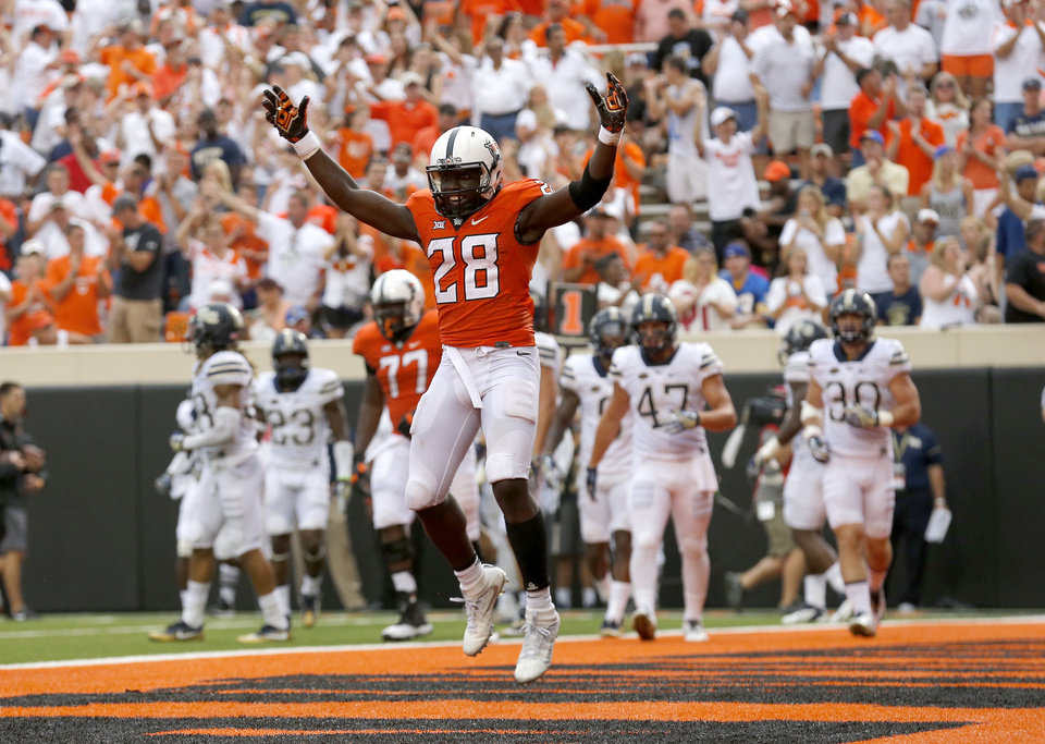 Photo - Oklahoma State's James Washington had a big day against the Pittsburgh secondary on Saturday at Boone Piickens Stadium in Stillwater. (Photo by Sarah Phipps, The Oklahoman)