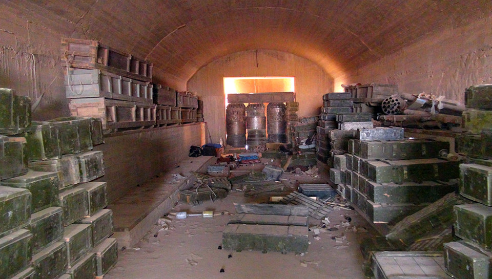 Photo - This undated image posted  Wednesday, Aug. 27, 2014 by the Raqqa Media Center of the Islamic State group, a Syrian opposition group, which has been verified and is consistent with other AP reporting, shows a munitions warehouse that was captured by the Islamic State group in the battle for the Tabqa air base in Raqqa, Syria on Sunday.   A U.N. commission on Wednesday accused the extremist Islamic State organization of committing crimes against humanity with attacks on civilians, as pictures emerged of the extremists' bloody takeover of a Syrian military air base that added to the international organization's claims.  (AP Photo/ Raqqa Media Center of the Islamic State group)