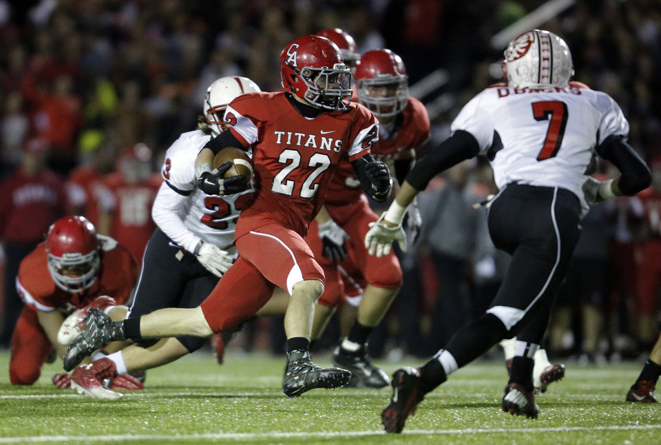 Photo - Carl Albert's Garrett Asher (22) runs the ball during a high school football game between Carl Albert and Claremore in Midwest City, Friday, Nov. 16, 2012.  Photo by Garett Fisbeck, The Oklahoman