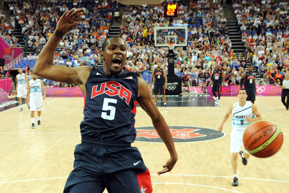 Photo - U.S. / UNITED STATES / TEAM USA: United States' forward Kevin Durant jumps for the ball during a men's semifinal basketball game against Argentina at the 2012 Summer Olympics on Friday, Aug. 10, 2012, in London. (AP Photo/Mark Ralston, Pool) ORG XMIT: OLY506