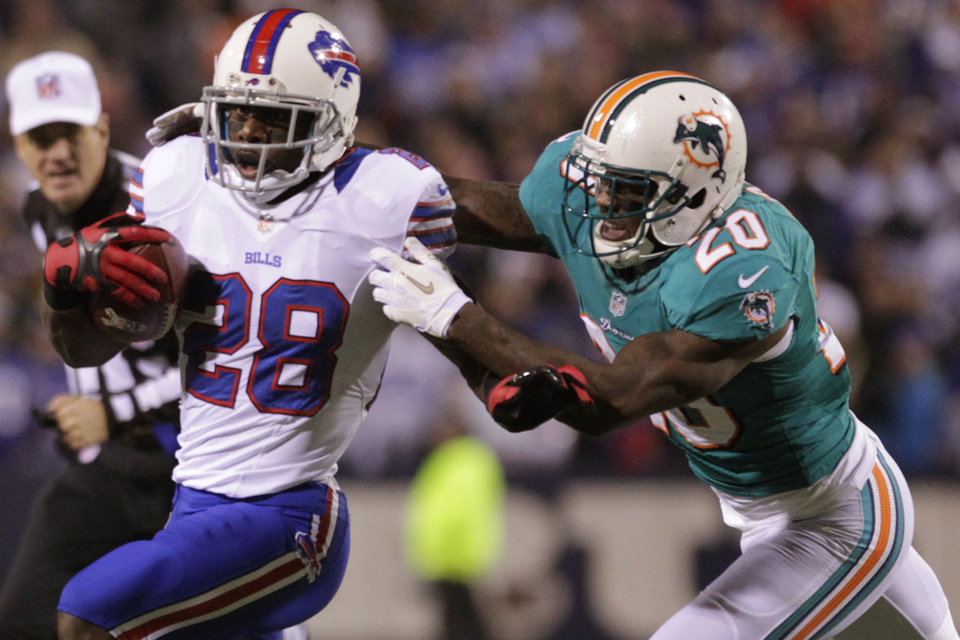 Photo -   Buffalo Bills running back C.J. Spiller (28) is tackled by Miami Dolphins' Reshad Jones (20) during the first half of an NFL football game on Thursday, Nov. 15, 2012, in Orchard Park, N.Y. (AP Photo/Bill Wippert)