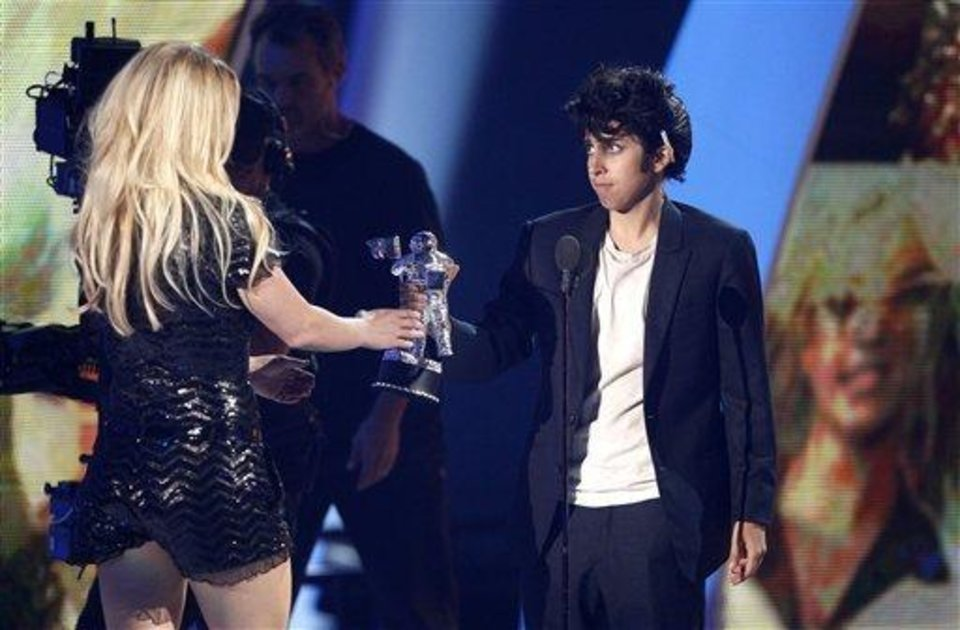 Photo - Lady Gaga, right, presents Britney Spears with the Video Vanguard award at the MTV Video Music Awards on Sunday Aug. 28, 2011, in Los Angeles. (AP Photo/Matt Sayles)