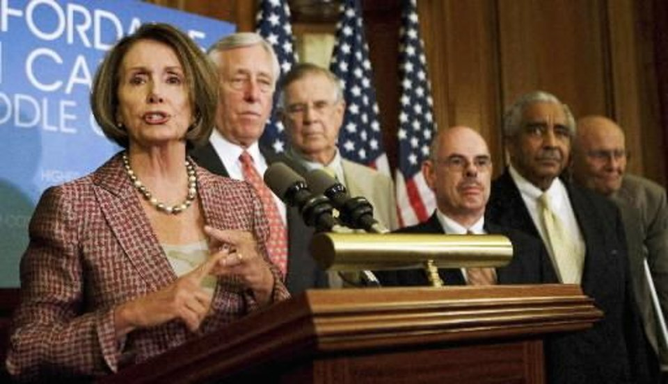 Photo - In this July 14, 2009 file photo, House Speaker Nancy  Pelosi, D-Calif., from left, is joined by other House Democratic leaders, House Majority Leader Steny Hoyer of Maryland, Pete Stark of California, Henry Waxman of California, Charles Rangel of New York, and John Dingell of Michigan, in a news conference announcing the introduction of  health  care legislation on Capitol Hill in Washington. (AP Photo/Manuel Balce Ceneta)
