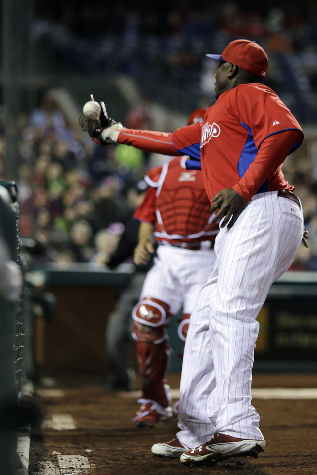 Philadelphia Phillies first baseman Ryan Howard cannot hang onto a pop foul by Toronto Blue Jays' Melky Cabrera during the third inning of an exhibition baseball game, Friday, March 29, 2013, in Philadelphia. (AP Photo/Matt Slocum)
