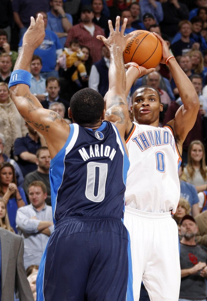 Oklahoma City's Russell Westbrook (0) takes a three-point shot in the fourth quarter over Shawn Marion (0) of Dallas during an NBA basketball game between the Oklahoma City Thunder and the Dallas Mavericks at Chesapeake Energy Arena in Oklahoma City, Thursday, Dec. 29, 2011. Oklahoma City won, 104-102. Photo by Nate Billings, The Oklahoman