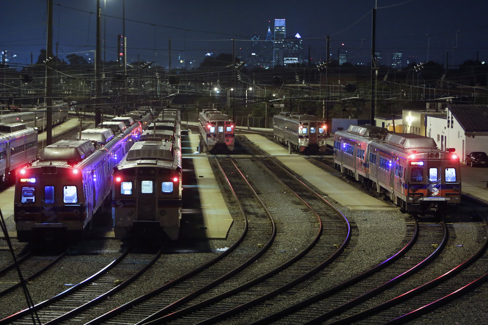 Photo - Commuter rail trains sit parked at the Roberts Avenue rail yard in Philadelphia on Saturday June 14, 2014, after members of the Brotherhood of Locomotive Engineers and Trainmen (BLET) union went on strike at 12:01 a.m. Saturday.  (AP Photo/ Joseph Kaczmarek)