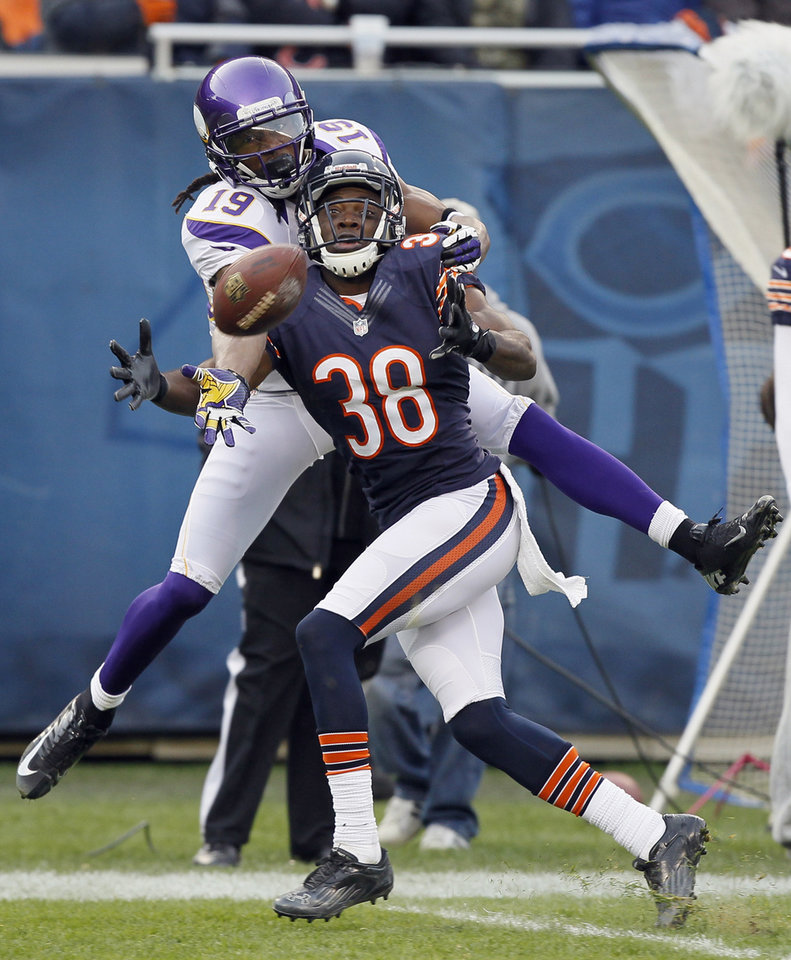 Chicago Bears defensive back Zack Bowman (38) breaks up a pass intended for Minnesota Vikings wide receiver Devin Aromashodu (19) in the second half of an NFL football game in Chicago, Sunday, Nov. 25, 2012. The Bears won 28-10. (AP Photo/Charles Rex Arbogast)