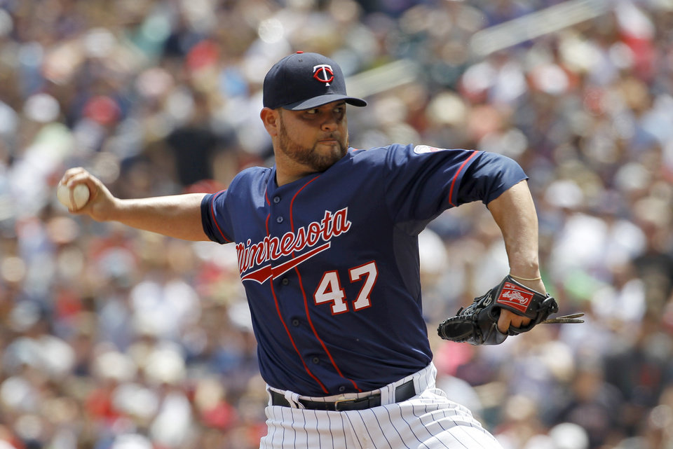 Photo - Minnesota Twins starting pitcher Ricky Nolasco delivers to the New York Yankees during the second inning of a baseball game in Minneapolis, Sunday, July 6, 2014. (AP Photo/Ann Heisenfelt)