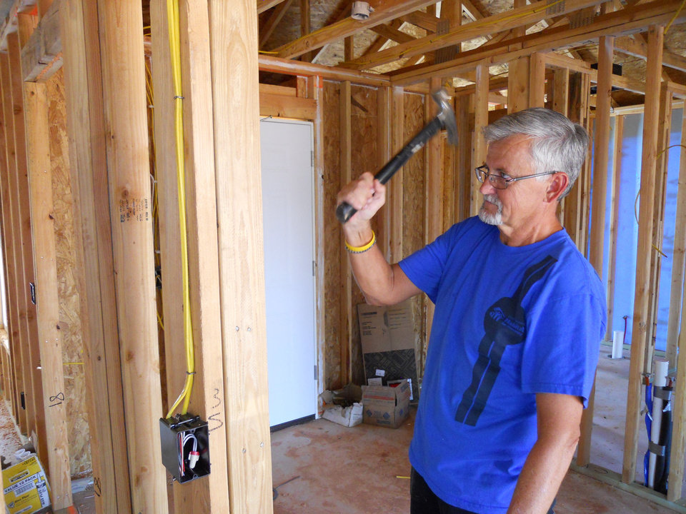 Photo - Gary Farnum works on a Central Oklahoma Habitat for Humanity home. Farnum, 58, lost some of his ability to speak and understand due to a brain disorder.   - Provided