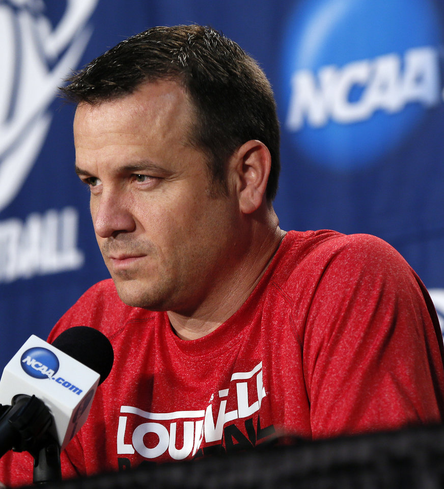 Photo - Louisville coach Jeff Walz listens to a question from the media during the press conference and practice day at the Oklahoma City Regional for the NCAA women's college basketball tournament at Chesapeake Energy Arena in Oklahoma City, Saturday, March 30, 2013. Photo by Nate Billings, The Oklahoman