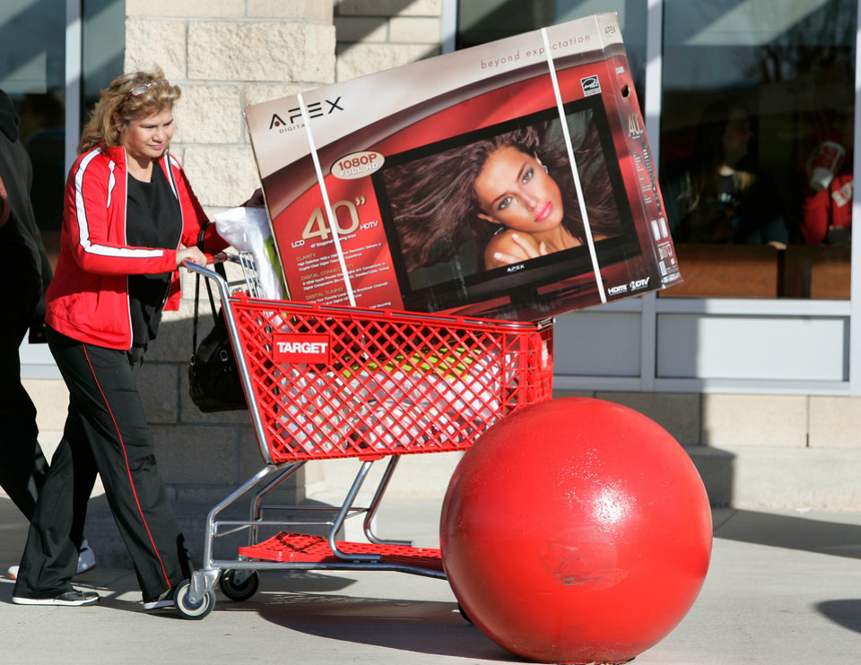 Photo - Tammy Starega takes a new TV to her car at Target in Midwest City, Oklahoma November 27, 2009. Photo by Steve Gooch, The Oklahoman