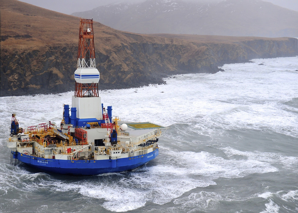 Photo - This aerial image provided by the U.S. Coast Guard shows the Royal Dutch Shell drilling rig Kulluk aground off a small island near Kodiak Island Tuesday, Jan. 1, 2013. No leak has been seen from the drilling ship that grounded off the island during a storm, officials said, as opponents criticized the growing race to explore the Arctic for energy resources. (AP Photo/U.S. Coast Guard)
