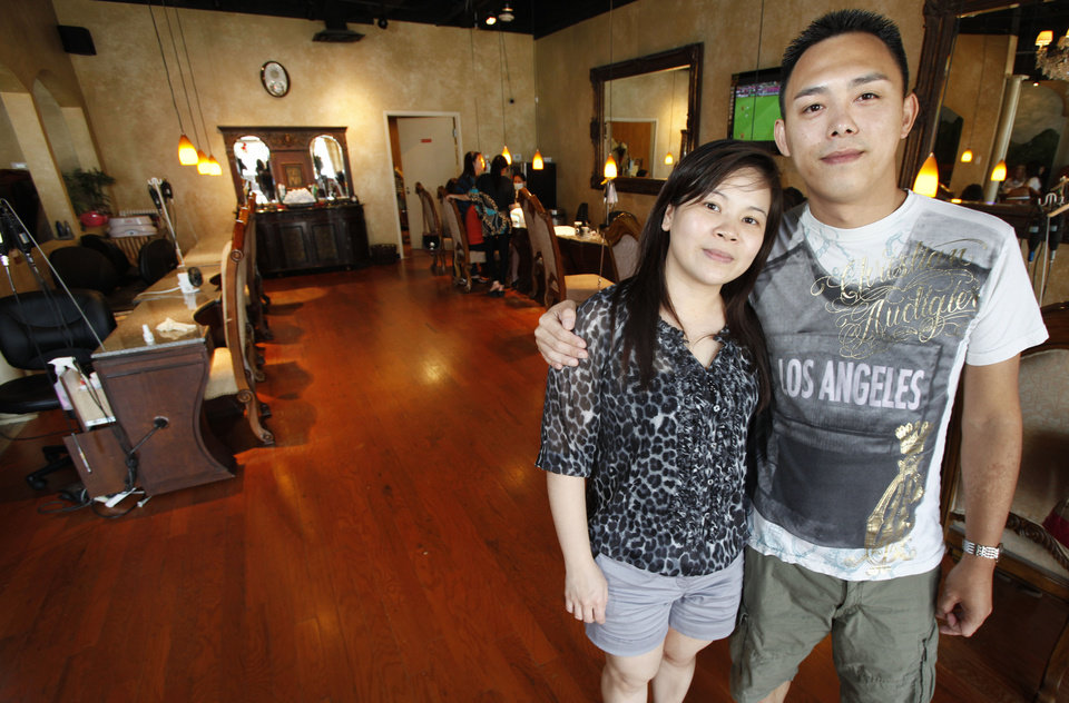 Photo - Tom Nguyen and his wife Tiffany, owners of Nails By Helen in Oklahoma City, Thursday, June 14, 2012. Photo By Steve Gooch, The Oklahoman
