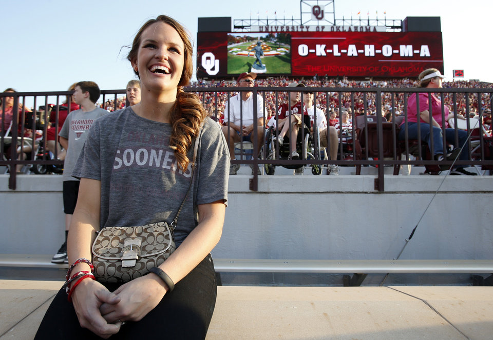 OU basketball player Whitney Hand, the wife of Sooners quarterback Landry Jones, waits near the end zone before the Sooners game vs. Kansas State on Sept. 22, 2012. PHOTO BY STEVE SISNEY, The Oklahoman