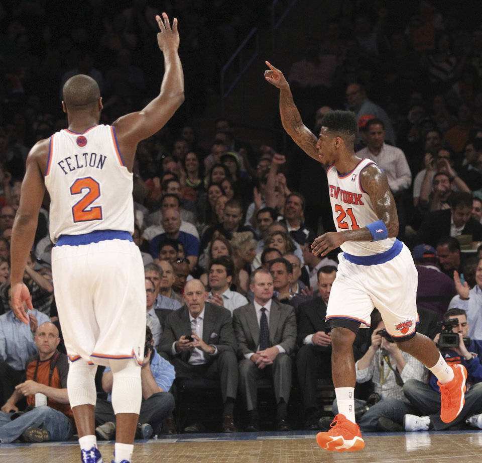 New York Knicks' Iman Shumpert (21) and Raymond Felton gesture after Shumpert made a three-point basket in the first half of an NBA basketball game against the Washington Wizards, Tuesday, April 9, 2013, at Madison Square Garden in New York. The Kincks won 120-99.  (AP Photo/Mary Altaffer)