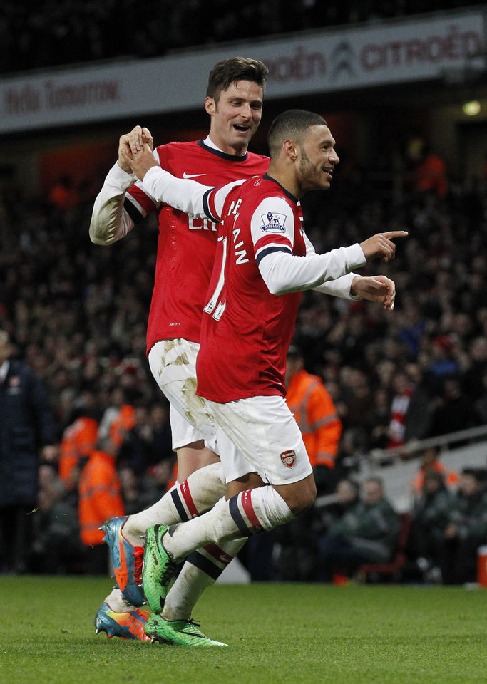 Photo - Arsenal's Alex Oxlade-Chamberlain, right, celebrates his his second against Crystal Palace with teammate Olivier Giroud during their English Premier League soccer match at Emirates Stadium in London, Sunday, Feb. 2, 2014. (AP Photo/Sang Tan)
