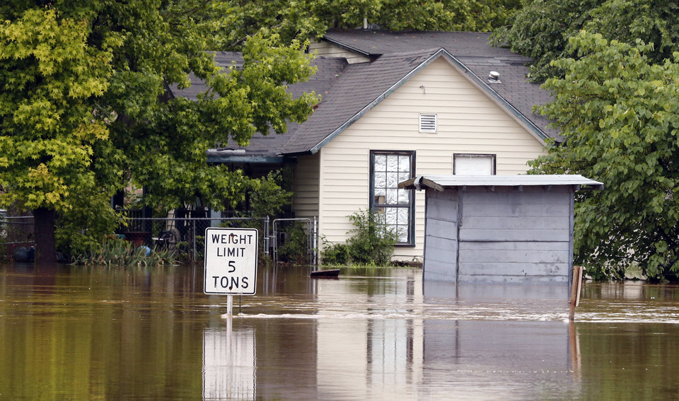 Photo - Water levels from Saturday night's storms have dropped several feet on Sunday, May 24, 2015 in Lexington Okla.  Photo by Steve Sisney The Oklahoman