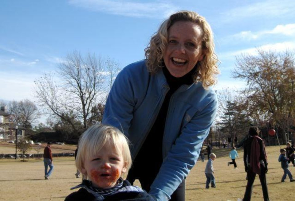 THANKSGIVING MORNING AT KITE PARK....Graham Murphy, 2, and Jill  Holzbeierlein are ready for the kickball game and party given by  Helen and Bob Sulllivan and Kathy and Russ Walker. (Photo by Helen Ford Wallace).