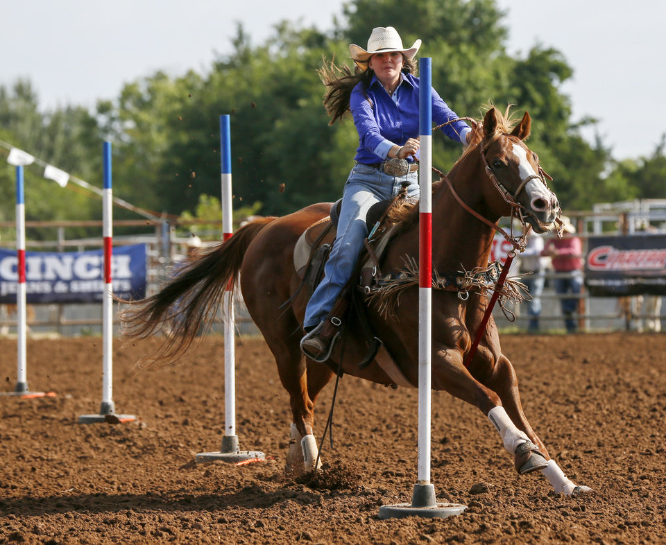 Photo - Emma Smith of Pleasanton, Texas, competes in pole bending during the International Finals Youth Rodeo at the Heart of Oklahoma Exposition Center in Shawnee, Okla., Thursday morning, July 11, 2019. [Nate Billings/The Oklahoman]