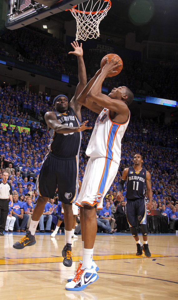 Oklahoma City's Kevin Durant (35) shoots as Zach Randolph (50) of Memphis defends him during game 7 of the NBA basketball Western Conference semifinals between the Memphis Grizzlies and the Oklahoma City Thunder at the OKC Arena in Oklahoma City, Sunday, May 15, 2011. Photo by Sarah Phipps, The Oklahoman