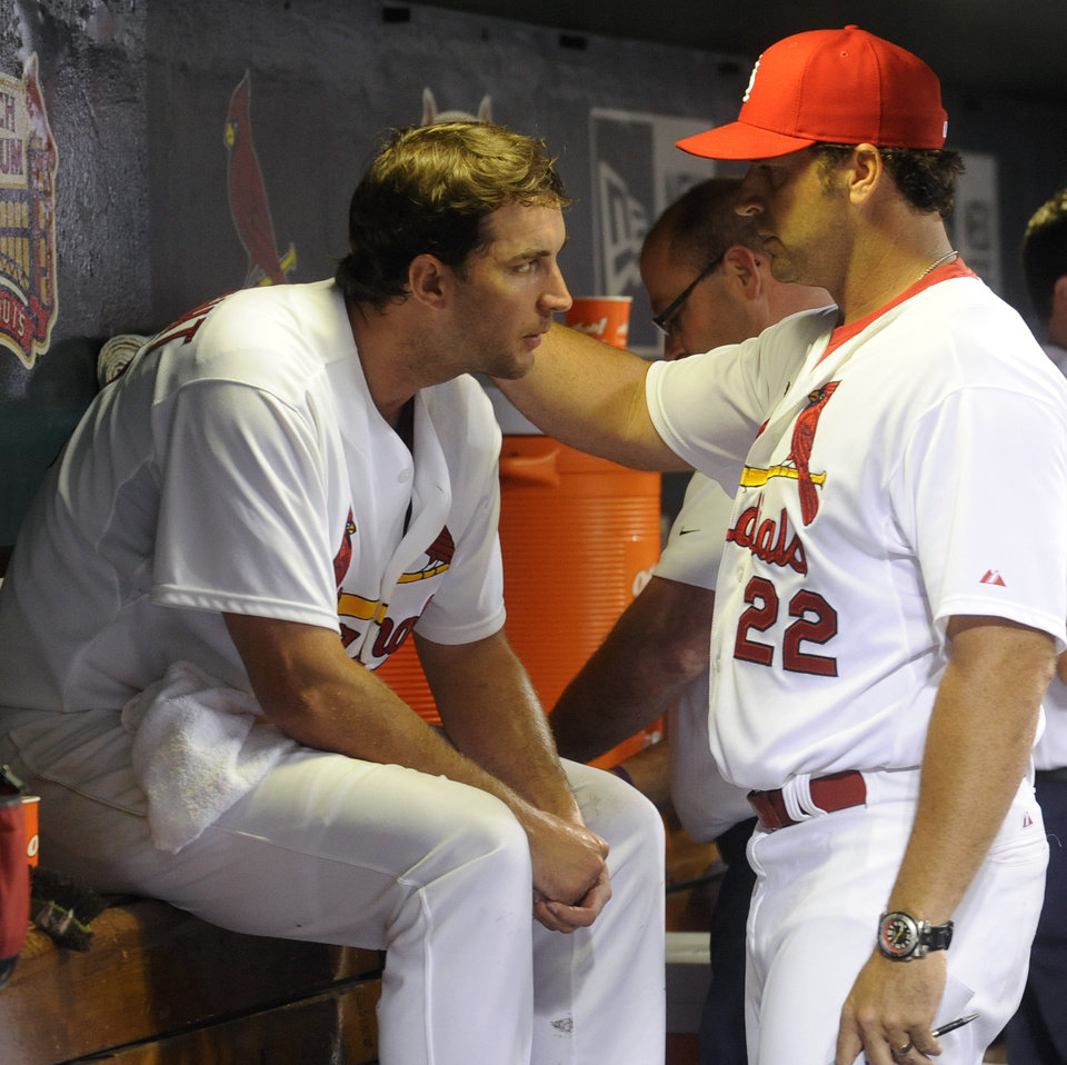 Photo - St. Louis Cardinals' manager Mike Matheny talks with starting pitcher Adam Wainwright after the seventh inning against the Boston Red Sox in a baseball game, Thursday, August 7, 2014, at Busch Stadium in St. Louis. (AP Photo/Bill Boyce)