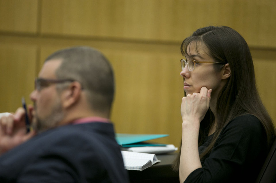 Photo - Defendant Jodi Arias listens during redirect of Alyce LaViolette, a domestic violence expert, during Arias's trial at Maricopa County Superior Court in Phoenix on Thursday, April 11, 2013.   Arias is on trial for the killing of her boyfriend, Travis Alexander, in 2008.  Arias faces a possible death sentence if convicted of first-degree murder.  (AP Photo/The Arizona Republic, David Wallace, Pool)