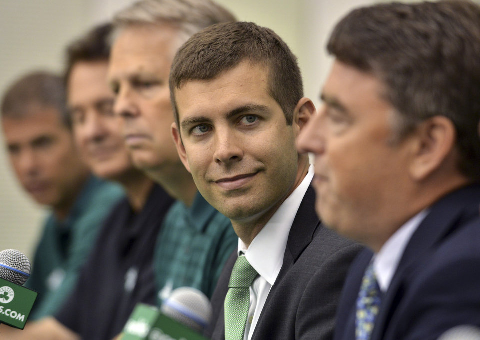 Photo - New Boston Celtics head coach Brad Stevens center, sits with, from left, Celtics President Rich Gotham, co-owner Stephen Pagliuca General Manager Danny Ainge, and co-owner and CEO Wyc Grousbeck, right, during a news conference Friday, July 5, 2013, at the NBA Basketball team's training facility in Waltham, Mass. Stevens, who twice led the Butler Bulldogs to the NCAA title game, replaces Doc Rivers, who was traded to the Los Angeles Clippers. (AP Photo/Josh Reynolds)