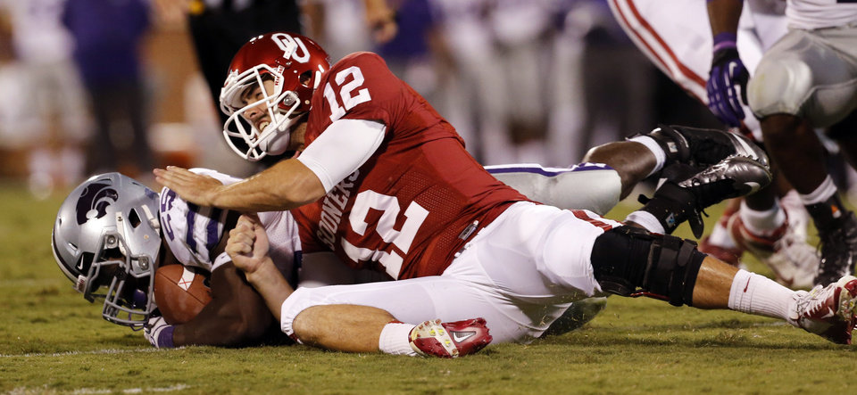 Photo - Joseph Bonugli (25) and quarterback Landry Jones (12) fight for a ball initially called a fumble that was later reversed to an attempted forward pass during the second half of a college football game where the University of Oklahoma Sooners (OU) lost 24-19 to the Kansas State University Wildcats (KSU) at Gaylord Family-Oklahoma Memorial Stadium, Saturday, September 22, 2012. Photo by Steve Sisney, The Oklahoman
