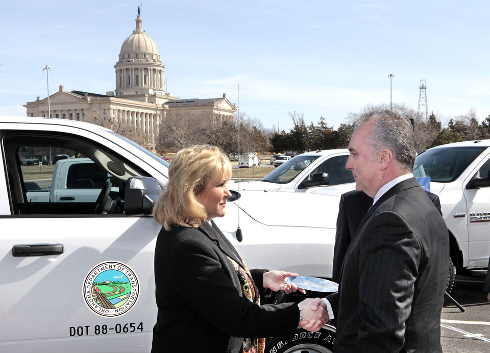 Governor Mary Fallin  shakes hands with Peter Grady, Vice President of Network Development and Fleet-Chrysler Group LLC at a ceremony to receive CNG trucks purchased by the state for use by Oklahoma Department of Transportation , Wednesday, March 6, 2013. Photo By David McDaniel/The Oklahoman