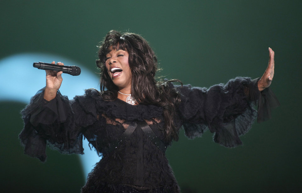 Photo - FILE - This Dec. 11, 2009 file photo shows Donna Summer performing at the Nobel Peace concert in Oslo, Norway. The eclectic group of rockers Rush and Heart, rappers Public Enemy, songwriter Randy Newman,