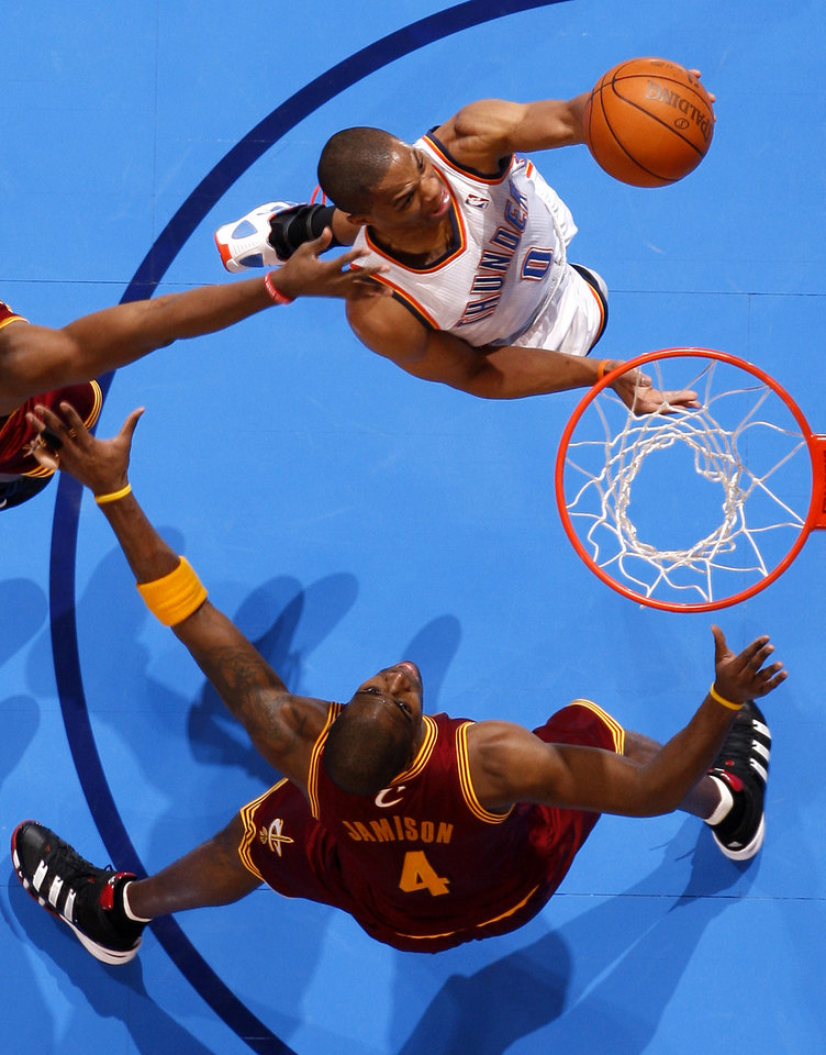 Photo - Oklahoma City's Russell Westbrook (0) drives to the basket beside Cleveland's Antawn Jamison (4) during the NBA basketball game between the Oklahoma City Thunder and the Cleveland Cavaliers at Chesapeake Energy Arena in Oklahoma City, Friday, March 9, 2012. Photo by Bryan Terry, The Oklahoman