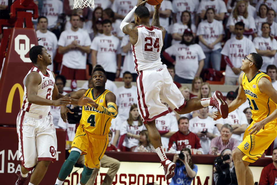 Photo - Oklahoma Sooner's Romero Osby (24) gets a rebound between Baylor Bear's Gary Franklin (4) and Isaiah Austin (21) in the second half as the University of Oklahoma Sooners (OU) men defeat the Baylor University Bears (BU) 90-76 in NCAA, college basketball at The Lloyd Noble Center on Saturday, Feb. 23, 2013  in Norman, Okla. Photo by Steve Sisney, The Oklahoman