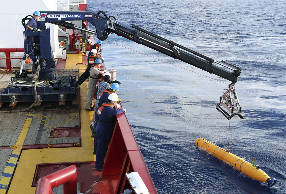 Photo - In this Monday, April 14, 2014, photo provided by the Australian Defense Force an autonomous underwater vehicle is deployed from ADV Ocean Shield in the search of the missing Malaysia Airlines Flight 370 in the southern Indian Ocean. The search area for the missing Malaysian jet has proved too deep for the robotic submarine which was hauled back to the surface of the Indian Ocean less than half way through its first seabed hunt for wreckage and the all-important black boxes, authorities said on Tuesday. (AP Photo/Australian Defense Force, Lt. Kelli Lunt) EDITORIAL USE ONLY