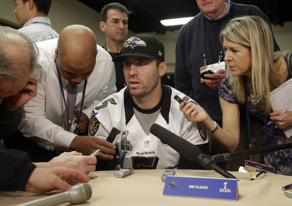 Baltimore Ravens quarterback Joe Flacco, center, speaks with reporters at an NFL Super Bowl XLVII football news conference on Wednesday, Jan. 30, 2013, in New Orleans. The Ravens face the San Francisco 49ers in Super Bowl XLVII on Sunday, Feb. 3. (AP Photo/Patrick Semansky)