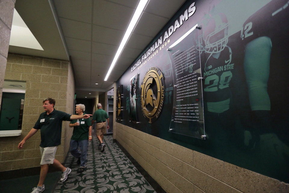 Photo - In this Monday, Aug. 25, 2014, photo, people leave the Rachel Fairman Adams Spartans Locker Room during a tour of the new North End Zone Complex renovations at Spartan Stadium on the Michigan State Campus in East Lansing, Mich. (AP Photo/Detroit Free Press, Ryan Garza)  DETROIT NEWS OUT, TV OUT, INTERNET OUT, MAGS OUT, NO SALES, MANDATORY CREDIT DETROIT FREE PRESS