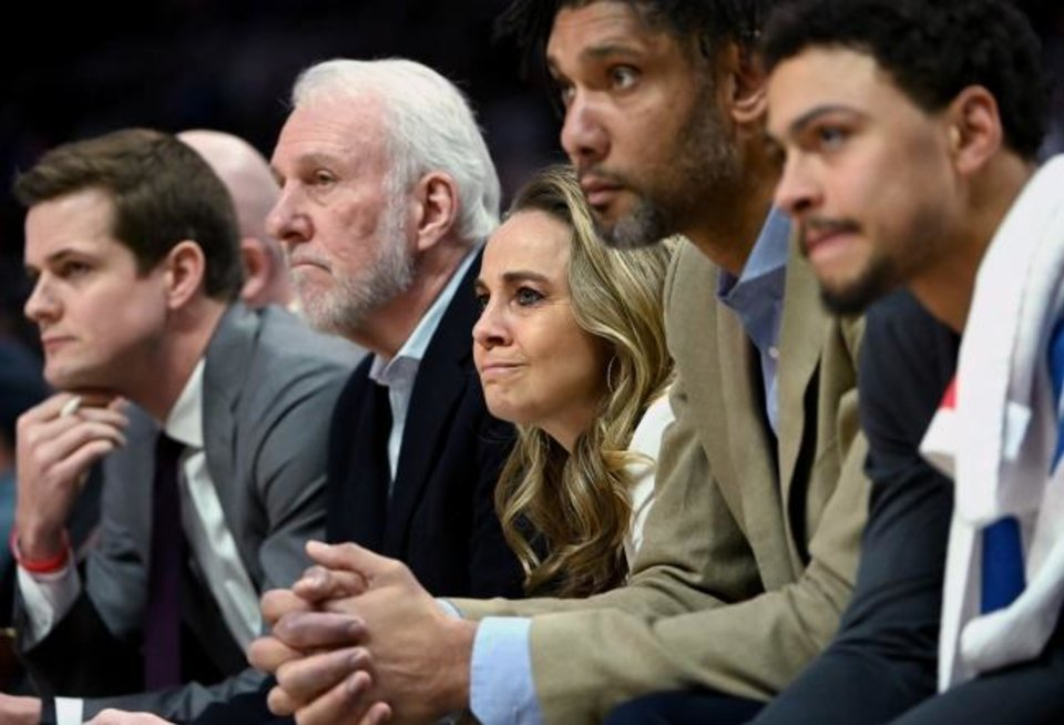 Photo -  Becky Hammon, center, has been a front-row assistant for Spurs coach Gregg Popovich since 2018. It's a spot reserved for only the most trusted of a head coach's assistants. For Hammon, it could help springboard her to history -- becoming the first woman hired as an NBA head coach. [JAYNE KAMIN-ONCEA/USA TODAY SPORTS]
