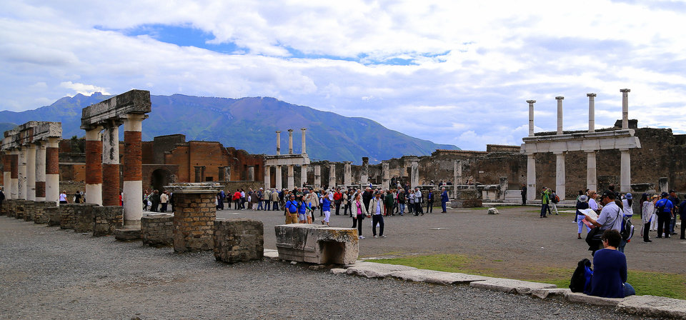 Photo - In this May 14, 2014 photo, tourists stroll past the remains of Pompeii's forum. The ancient town of Pompeii, located near modern-day Naples, Italy, was destroyed in A.D. 79 following the eruption of Mount Vesuvius.  An estimated 2.5 million people visit the site each year. (AP Photo/Michelle Locke)